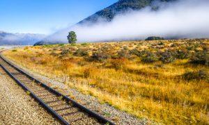 Railway-in-Mountain-fields-landscape-New-Zealand